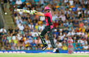 Daniel Hughes jumps in the air to execute a cut shot, Brisbane Heat v Sydney Sixers, Big Bash League 2016-17, semi-final, Brisbane, January 25, 2017