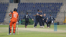 Scotland celebrates after Paul van Meekeren is run out to end the match, Netherlands v Scotland, Desert T20, Group B, Abu Dhabi, January 17, 2017