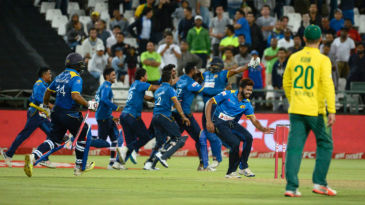 Sri Lanka's players storm the field after sealing a 2-1 series win