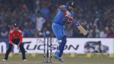 Suresh Raina navigates a short-pitched delivery