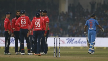 England players celebrate after Manish Pandey fell cheaply