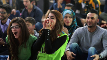 Pakistan fans watch the India-Pakistan match on a big screen in Islamabad