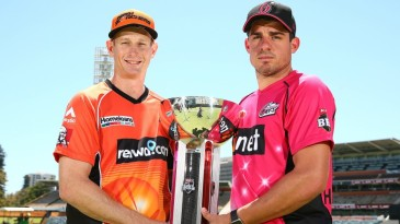 Adam Voges and Moises Henriques pose with the Big Bash League trophy