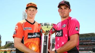 Adam Voges and Moises Henriques pose with the Big Bash League trophy