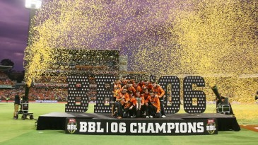 The Perth Scorchers players celebrate their title