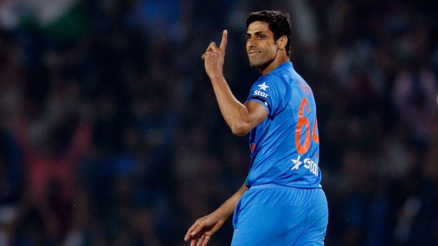 A pleased-looking Ashish Nehra gestures in the field