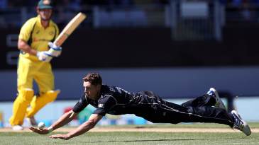 Mitchell Santner dives to make a save off his bowling