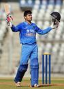 Himanshu Rana raises his bat after reaching a century, India v England, 1st Under-19 ODI, Mumbai, January 30, 2017