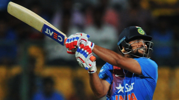 Suresh Raina muscles the ball away