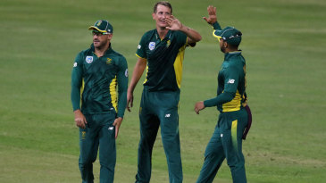 Chris Morris celebrates the wicket of Dinesh Chandimal