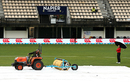 Ground staff tend to the covers following a spell of rain before the match, New Zealand v Australia, 2nd ODI, Napier, February 2, 2017