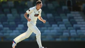 Simon Mackin celebrates a wicket