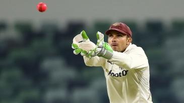 Chris Hartley keeps wicket