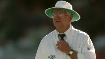 Umpire Cyril Mitchley stands in the Barbados Test