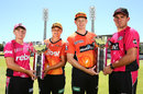 Alyssa Healy, Suzie Bates Adam Voges and Moises Henriques pose with the women's and men's Big Bash League trophies, Perth, January 27, 2017