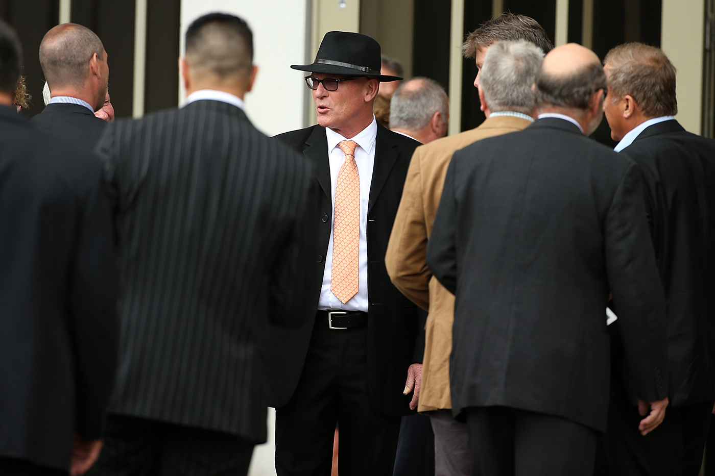 Brother Jeff Crowe greets mourners at the funeral