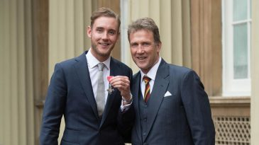 Stuart Broad poses with his MBE alongside his father Chris Broad