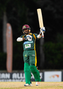 Kavem Hodge raises his bat after reaching his maiden List A fifty, Kent v Windward Islands, Regional Super50, Group A, Coolidge, February 10, 2017