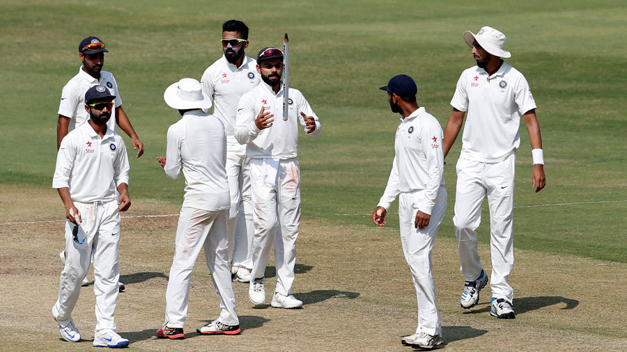 Virat Kohli takes a souvenir with him, after India seal victory