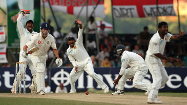 Muttiah Muralitharan appeals for the wicket of James Anderson