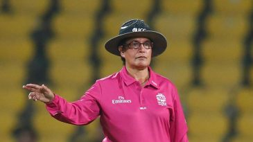 Umpire Kathy Cross signals a four