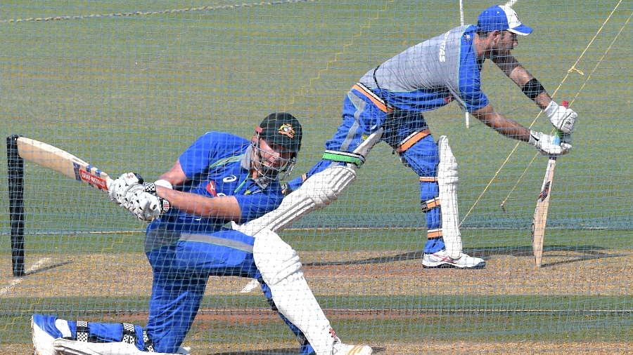 Matt Renshaw and Glenn Maxwell try a variety of shots during practice