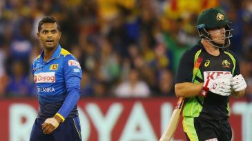 Asela Gunaratne gives Aaron Finch a send off