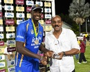 Jason Holder receives the trophy from Antigua and Barbuda Prime Minister Gaston Browne, Barbados v Jamaica, WICB Regional Super50 2016-17, Final, Antigua, February 15, 2017