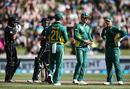 JP Duminy, AB de Villiers and Quinton de Kock wait on a review for Tom Latham's wicket, New Zealand v South Africa, 1st ODI, Hamilton, February 19, 2017