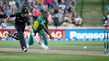 Kagiso Rabada has a shy at the stumps in a bid to run Tim Southee out