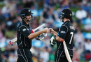 Tim Southee and Colin de Grandhomme share a fist bump during their rapid stand, New Zealand v South Africa, 1st ODI, Hamilton, February 19, 2017