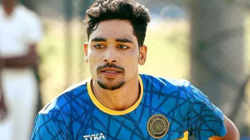 Mohammed Siraj runs in to bowl during a training session