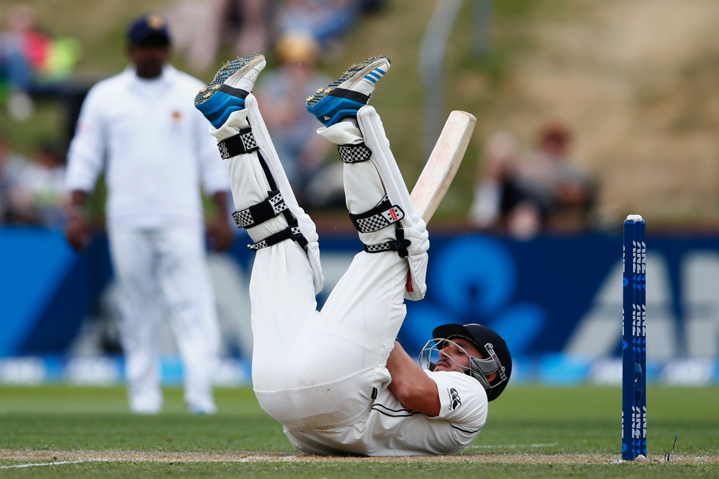 Hamish Rutherford falls over while batting