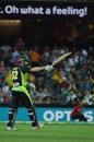 Michael Klinger raises his bat after reaching his fifty, Australia v Sri Lanka, 3rd T20 International, Adelaide, February 22, 2017
