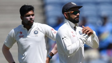 Virat Kohli asks the umpire for a review as Umesh Yadav looks on