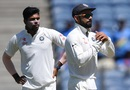 Virat Kohli asks the umpire for a review as Umesh Yadav looks on, India v Australia, 1st Test, Pune, 1st day, February 23, 2017