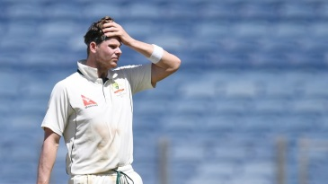 Steven Smith has a moment to himself during a drinks break