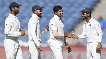 Umesh Yadav is congratulated by Ajinkya Rahane, Virat Kohli and Cheteshwar Pujara