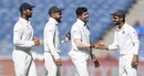 Umesh Yadav is congratulated by Ajinkya Rahane, Virat Kohli and Cheteshwar Pujara, India v Australia, 1st Test, Pune, 1st day, February 23, 2017