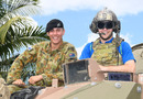 Mick Lewis (under helmet) poses on a tank, Townsville, August 18, 2016