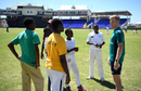 Sam Billings chats with young cricketers during a training session at Warner Park, St Kitts, February 23, 2017