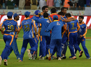 Team-mates mob Kieron Pollard after Karachi Kings' win, Karachi Kings v Lahore Qalandars, PSL 2016-17, Dubai, February 25, 2017