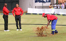 Umpires Jeremiah Matibiri and Shaun George watch ground staff attempt to dry the outfield, Zimbabwe v Afghanistan, 5th ODI, Harare, February 26, 2017