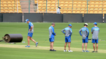 The Australian team take a look at the pitch ahead of the game