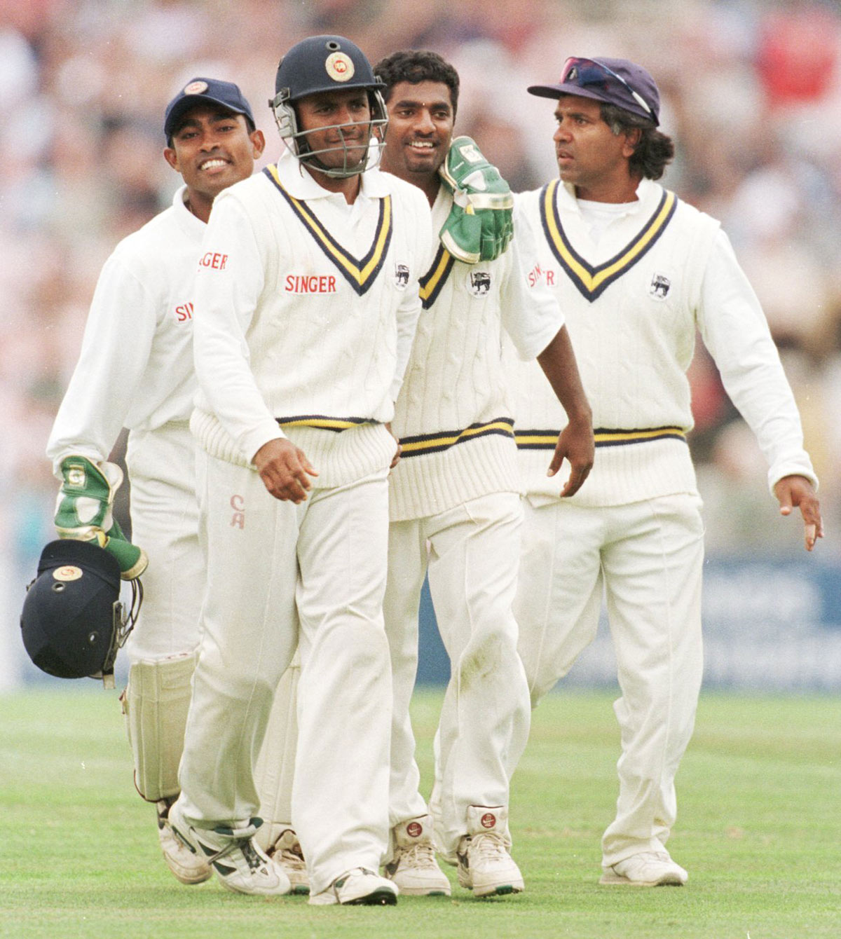 The svelte (ish) years: Ranatunga walks off the field with main man Murali after the win at The Oval in 1998