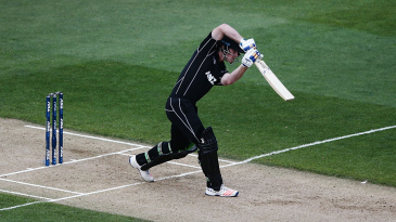 James Neesham drives down the ground