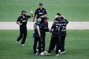 Colin de Grandhomme is mobbed by team-mates after the dismissal of Hashim Amla, New Zealand v South Africa, 5th ODI, Auckland, March 4, 2017