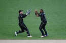 Jeetan Patel celebrates with Luke Ronchi after taking a wicket, New Zealand v South Africa, 5th ODI, Auckland, March 4, 2017