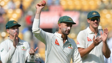 Nice Garry: Nathan Lyon holds the ball up after claiming 8 for 50