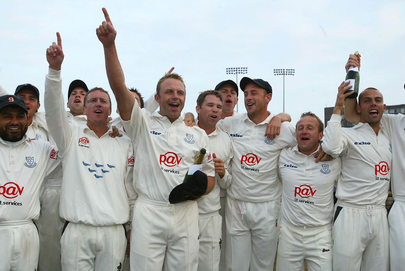 Sussex celebrate their County Championship triumph during play